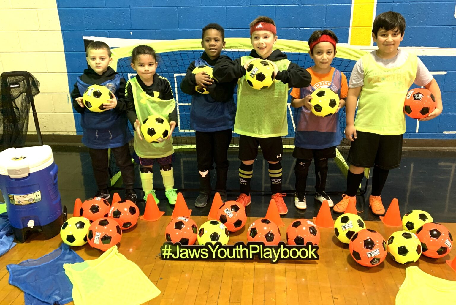 Jaws Youth Playbook Donates Soccer Equipment to the Kensington Soccer Club