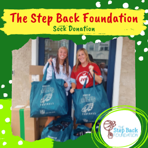 Jaws Youth Playbook donates socks to The Step Back Foundation